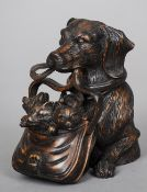 A Black Forest type carved wooden inkwell Formed as a dog carrying a bag of kittens.  12.5 cm