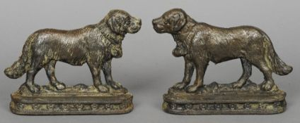 A pair of cast iron mantel ornaments Each formed as a St. Bernard.  Each 24 cm wide.  (2)