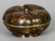 A Chinese cloisonne box and cover Formed as a pumpkin, decorated in the round with floral motifs.