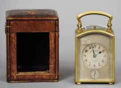 A small late 19th century cased repeating carriage clock The silvered dial with Arabic numerals