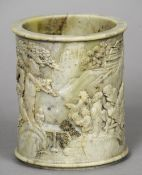 A 19th century Chinese carved soapstone brush pot Decorated in the round with figures and pagodas