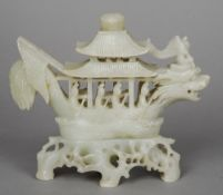 A Chinese carved soapstone model of a dragon boat Typically modelled, on a pierced soapstone