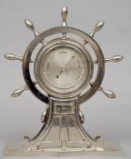A 19th century chromed desk top barometer by or retailed by Betjemann Formed as a ship's wheel,