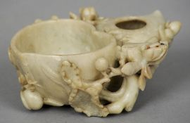 A Chinese carved hardstone brush washer Decorated with fruiting branches.  14 cm wide. CONDITION