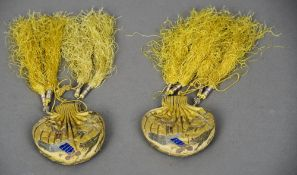 A pair of Chinese gold and silver thread worked silk snuff bottle purses Each worked with a