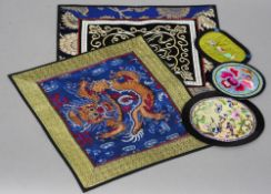 Two Chinese needlework rank badges Together with three further small Chinese embroidered panels. The