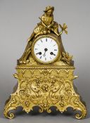 A 19th century gilt bronze mantel clock The white enamelled dial with Roman numerals surmounted with
