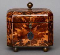 A 19th century ivory strung tortoiseshell tea caddy Of domed canted rectangular form, the panelled