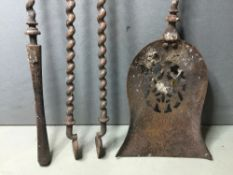 A set of three 19th century polished steel fire irons Of spiral form, the shovel with a pierced