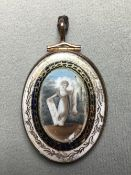 A George III memento mori Painted on ivory with a classical maiden in verre eglomise frame, the