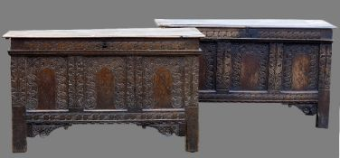 A near pair of 17th century carved oak Norfolk coffers The moulded rectangular top above the