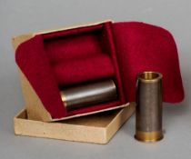 A boxed pair of 12 bore snap caps made from damascus barrels