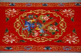 Two mid 20th century Chinese red silk panels, possibly wedding banners Both typically worked with