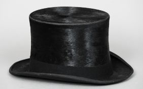 "A black silk top hat by C.A. Dunn & Co. London, size 7 1/8"" CONDITION REPORTS: Generally in good"