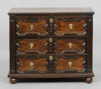 A 17th century oak chest of drawers The moulded rectangular top above the geometrically moulded
