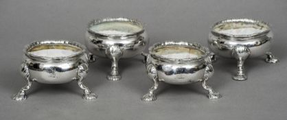A matched set of four George III silver table salts, one pair hallmarked London 1754, maker's mark
