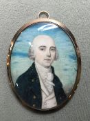 A George III portrait miniature of a gentleman Wearing a blue jacket, on ivory, gold framed, the