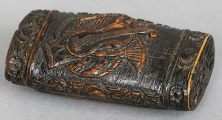 A 19th century carved coquilla nut snuff box Decorated with musical trophies.  7 cm wide.