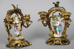 A pair of 19th century gilt bronze twin branch candle stands Each mounted with a porcelain figure.
