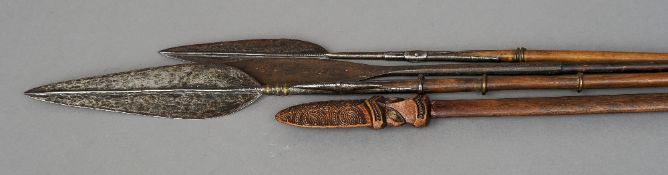 An African tribal spear, probably Masai With flattened blade and metal mounted shaft; together