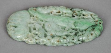 A Chinese carved jade disc Worked with mythical beasts amongst flowering fruit and vegetables.  10