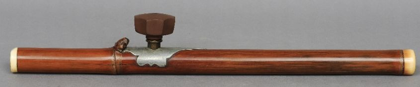 A large Chinese ivory mounted bamboo pipe with Yinxing pottery bowl The shaft carved with a toad,