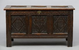 A 17th century carved oak panelled coffer  With three panel front.  129 cm wide. CONDITION