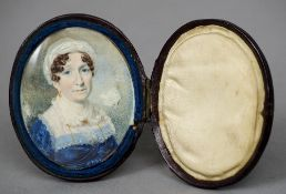 An early 19th century portrait miniature on ivory Depicting a middle aged woman wearing a lace cap