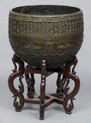 A large Chinese bronze temple bell The domed exterior with a band of lappet and foliate decoration