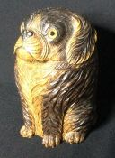 A Black Forest carved wooden jar and cover Formed as a dog with glass inset eyes.  15.5 cm high.