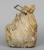 A mammoths tooth Adapted as a doorstop with swing handle.  33.5 cm high overall. CONDITION