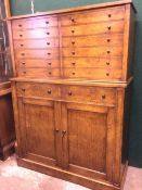 A burr oak collectors cabinet The upper section fitted with twelve drawers, the lower section with