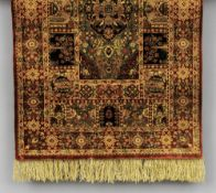 A small Persian silk prayer rug With central medallion and a vignette filled border.  65 cm long; 47