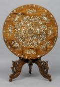 A 19th century Chinese mother-of-pearl inlaid hardwood tilt-top tripod table The circular top