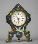 A miniature enamelled decorated gilt metal cased mantel clock The white dial with Roman numerals,