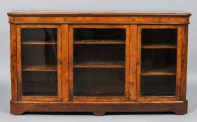 A Victorian burr walnut triple door credenza The moulded canted rectangular top above the line