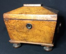A 19th century sarcophagus form tea caddy With twin lidded internal compartments.  Approximately
