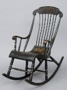 A 19th century chinoiserie lacquered stick back rocking chair The curved top rail above the sweeping