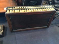 A Chinese hardwood box The sides mounted with abacus beads.  20 cm wide. CONDITION REPORTS: