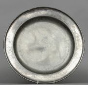 An 18th century English pewter charger with London touch marks 42 cm diameter. CONDITION REPORTS:
