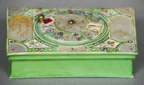 An 18th century French stained ivory game counter The hinged rectangular lid centred with a rotating