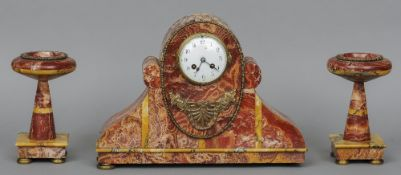 A red marble triple clock garniture  The clock with white painted dial and bell striking barrel
