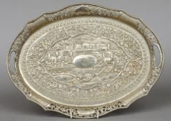 An early 20th century unmarked Indian silver tray With a pierced border centrally decorated with