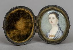 An 18th century portrait miniature on ivory Depicting a young lady wearing a suite of pearl