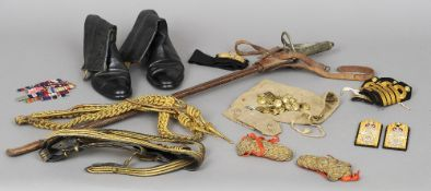 A George V Naval officers sword Of typical form with leather scabbard; together with five pairs of
