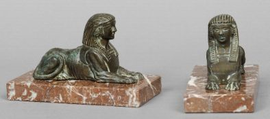 A pair of cast bronze sphinxes  Typically posed on marble plinth bases.  11.5 cm high.  (2)