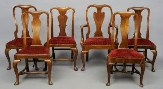 A harlequin set of six Queen Anne style walnut dining chairs, including a single carver Each with