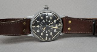 A World War II Luftwaffe pilot's wristwatch Of typical oversized form with a black dial.  5.5 cm