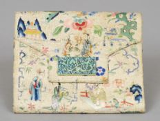 A Chinese silkwork purse Decorated with figures in a continuous garden with applied green stone