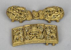 Two 19th century Chinese gilt metal dragon buckles Both worked with pierced and articulated dragons,